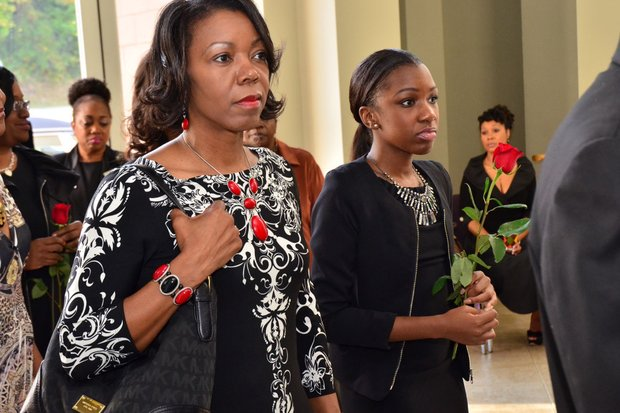 Paulisha Puggles (right) was Sheila Stewart's mentee. Stewart, a longtime radio personality in D.C., was killed Oct. 24 in an automobile accident in Atlanta. Her funeral service was held Oct. 30 at the University Park Baptist Church in Charlotte, N.C. (Paul Williams/Paul-3 Photography)