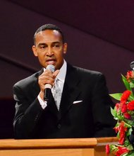 Patrick D. Cannon, mayor pro tem of Charlotte, N.C., speaks at the funeral service for Sheila Stewart at University Park Baptist Church in Charlotte on Oct. 30. Stewart, a longtime radio personality in D.C., was killed Oct. 24 in an automobile accident in Atlanta. (Paul Williams/Paul-3 Photography)
