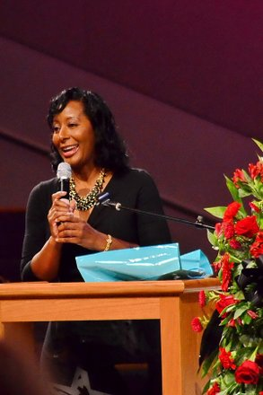 """Tanya Rivens, host of """"Sunday Morning Inspiration"""" on WPEG-FM and morning traffic reporter on WBTV in Charlotte, N.C., speaks at the funeral service for Sheila Stewart at University Park Baptist Church in Charlotte on Oct. 30. Stewart, a longtime radio personality in D.C., was killed Oct. 24 in an automobile accident in Atlanta. (Paul Williams/Paul-3 Photography)"""