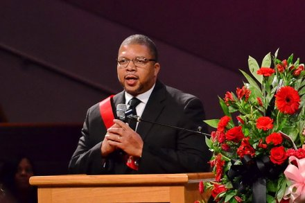 Tim McCollough, a classmate of Sheila Stewart from Great Falls (S.C.) High School, speaks at Stewart's funeral service at University Park Baptist Church in Charlotte, N.C., on Oct. 30. Stewart, a longtime radio personality in D.C., was killed Oct. 24 in an automobile accident in Atlanta. (Paul Williams/Paul-3 Photography)