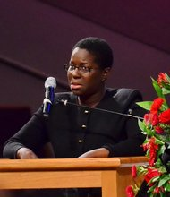 A church member and close friend of Sheila Stewart speaks at Stewart's funeral service at University Park Baptist Church in Charlotte, N.C., on Oct. 30. Stewart, a longtime radio personality in D.C., was killed Oct. 24 in an automobile accident in Atlanta. (Paul Williams/Paul-3 Photography)