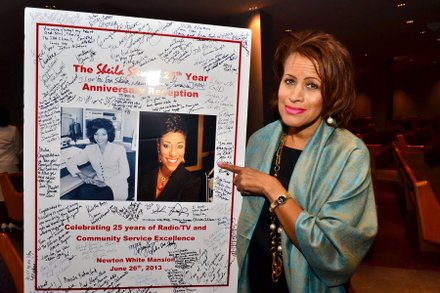 Renee Allen, of Prince George's County, stands by a poster expressing words of appreciation signed by friends and admirers of Sheila Stewart at her 25th anniversary celebration held in June at the Newton White Mansion.  (Paul Williams/Paul-3 Photography)
