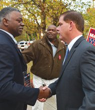 State Rep. Marty Walsh greets Louis Elisa outside the Reggie Lewis Track before a mayoral debate last week. (Photo courtesy of the Walsh campaign)