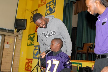 Torrey Smith, first grader Charles Bellamy and Anthony Felder, principal, Gwynn Falls Elementary School.