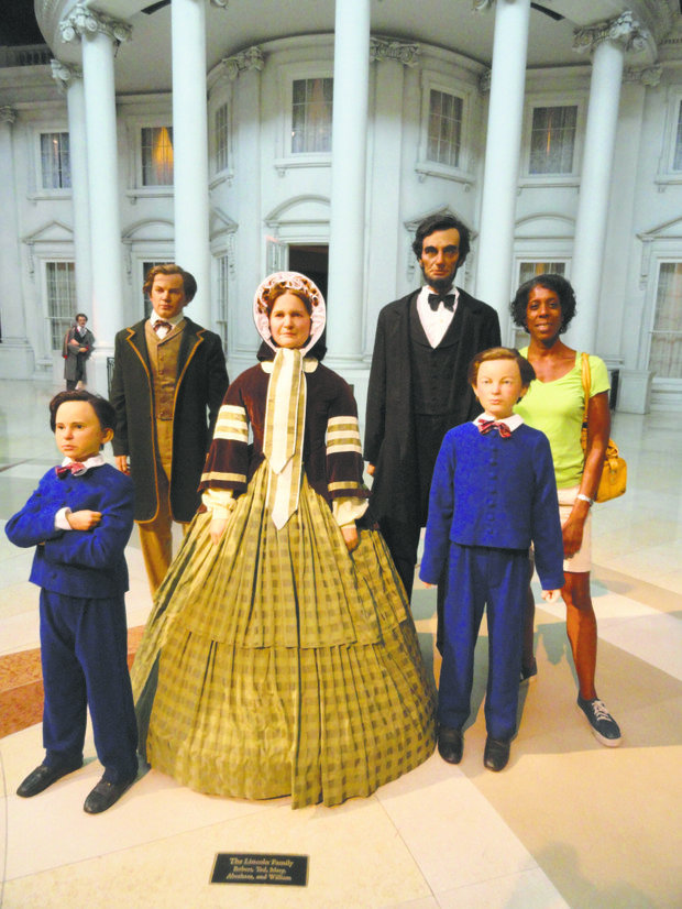 Life-size statues of the Lincoln family greet visitors in the grand foyer of the Abraham Lincoln Presidential Library & Museum, one of the best presidential museums in the country.