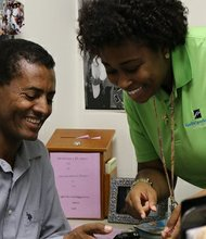 Obamacare navigator Jekisha Elliot helps Geremen Teklehaimanot sign up for health insurance in Baltimore