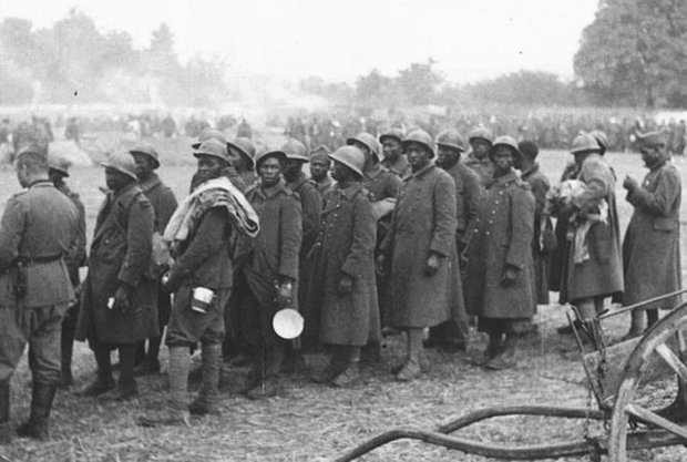 African French P.O.Ws rounded up by German soldiers, June 1940