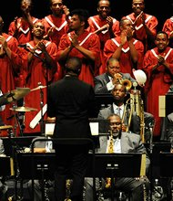 "This Oct. 8, 2013 photo shows the Jazz at Lincoln Center Orchestra with Wynton Marsalis, center, Chorale Le Chateau, and conductor Damien Sneed, performing ""Abyssinian Mass"" at Friendship Missionary Baptist Church in Charlotte, N.C. Marsalis has taken his Jazz at Lincoln Center Orchestra all the way to China and Russia, but the trumpeter says its current ""Abyssinian: A Gospel Celebration Tour"" is the most challenging in the band's 25-year history."