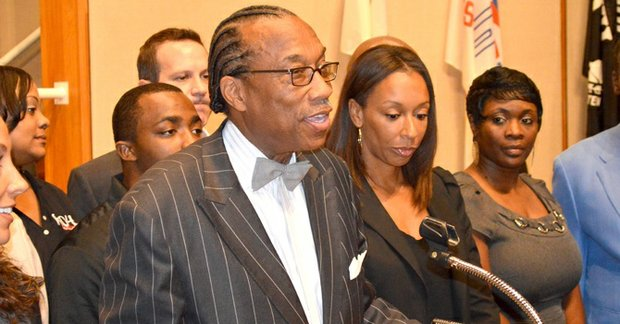 Commissioner John Wiley Price speaks during a press conference announcing that KwanzaaFest is back on schedule.