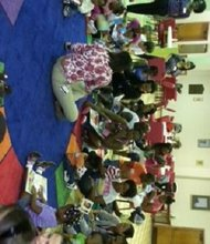 Parents and babies at a Promise University class