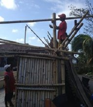 Photo of repairs getting underway in Kalibo, Philippines after Typhoon Haiyan.