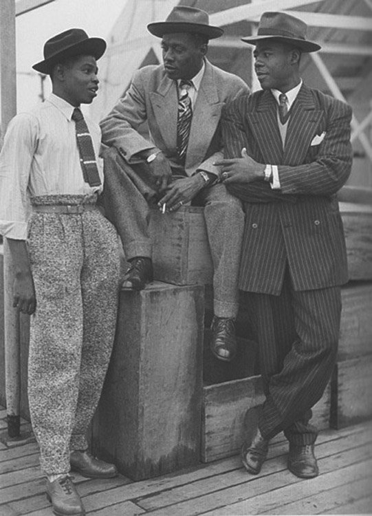 Caribbean men after disembarking the S.S. Empire Windrush in England (Courtesy photo)