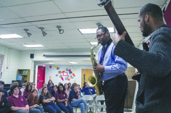 Prince George's County Councilman Derrick Leon Davis shares his musical talent with students at Washington New Church School in Mitchellville, Md., on Friday, Nov. 8.