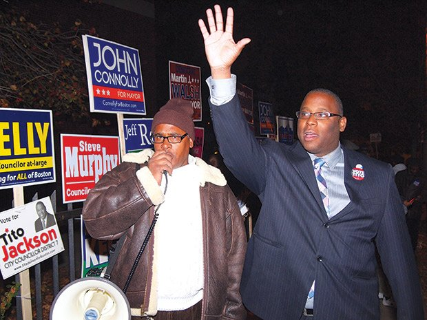 Political activist Tony Brewer and City Councilor Tito Jackson appeal to voters in front of the Lewis/Higginson School in Roxbury. (Yawu Miller photo)