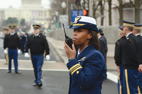 Former Portland resident Michelle Watson talks with her U.S. Coast Guard Reserve security team for President Obama's second inauguration last January. One of the first African American women to graduate from the Coast Guard Academy, she just finished a year in which she also met the President and First Lady, and was promoted as the first African-American woman to take command of a Coast Guard security unit in Ft. Eustis, Va.