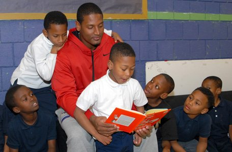 Baltimore Ravens tight end Ed Dickson read to children at Webster Kendrick Boys & Girls Club in Park Heights on ...