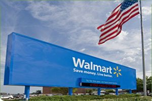 Just days before a high-end outlet mall is set to open in Oxon Hill, Wal-Mart has reignited its plans to ...