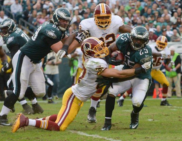 Philadelphia Eagles running back LeSean McCoy barrels through a Redskins defender.
