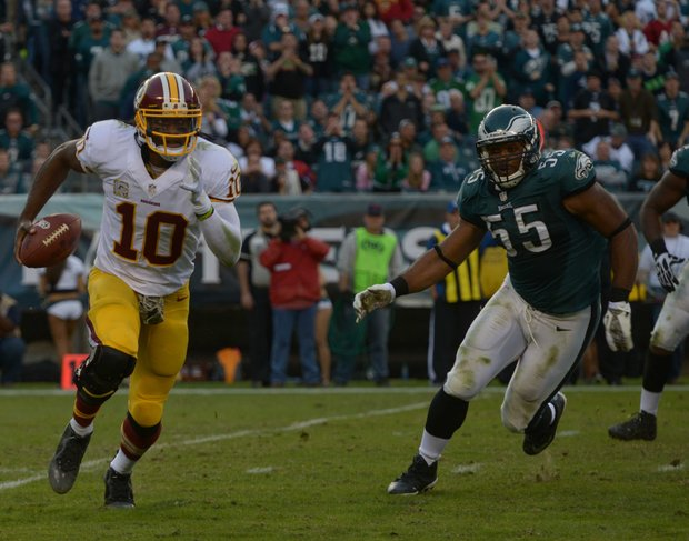 Washington Redskins QB Roberts Griffin, III picks up yardage in the fourth quarter.