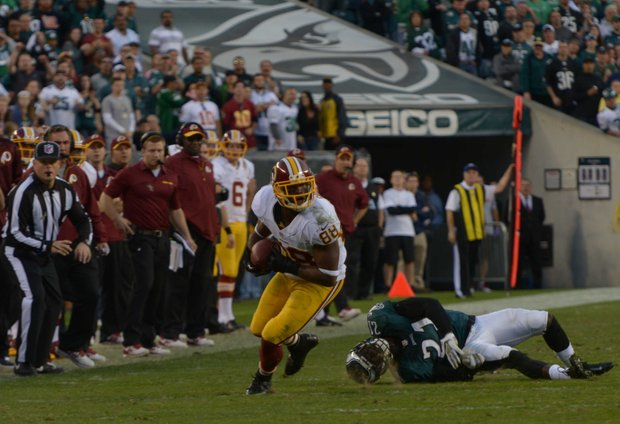 Washington Redskins wide receiver Pierre Garcon breaks a tackle for a long gain in the 4th quarter.