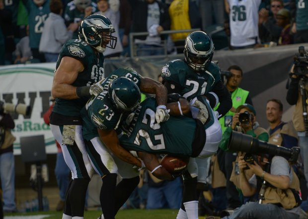 Philadelphia Eagles cornerback Brandon Boykin, center, celebrates after he caught an interception in the end zone in the 4th quarter.