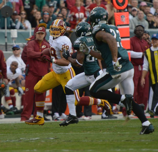 Washington Redskins running back Roy Helu, Jr. runs by Eagles defenders for a gain of 24 yards in the 2nd quarter. Redskins lose to the Eagles 16-24 on Sunday, November 17 at Lincoln Financial Field in Philadelphia.