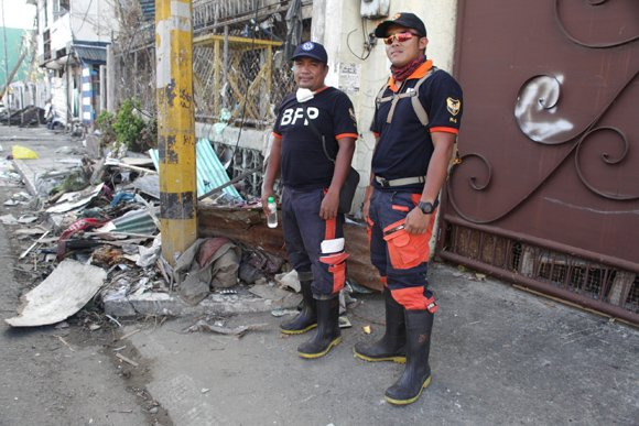 Don Pomposo, left, and Vincent Albert Garchi Torena — just two of many with the grisly task of removing the bodies of those killed by Typhoon Haiyan in and around Tacloban.
