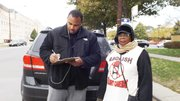 Tim Hughes stops to sign a petition during a protest held held at 53rd and Cottage Grove to abolish red-light enforcement and speed cameras that a group called Citizens to Abolish Red-light Cameras, led by Mark Wallace, of WVON, said are unfair and disproportionately located in African American communities.