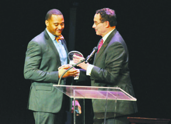 Mayor Vincent C. Gray presents Abdullah Zaki, the 2013 Principal of the Year, with an award during the annual Standing Ovation Awards for D.C. Teachers earlier this month.