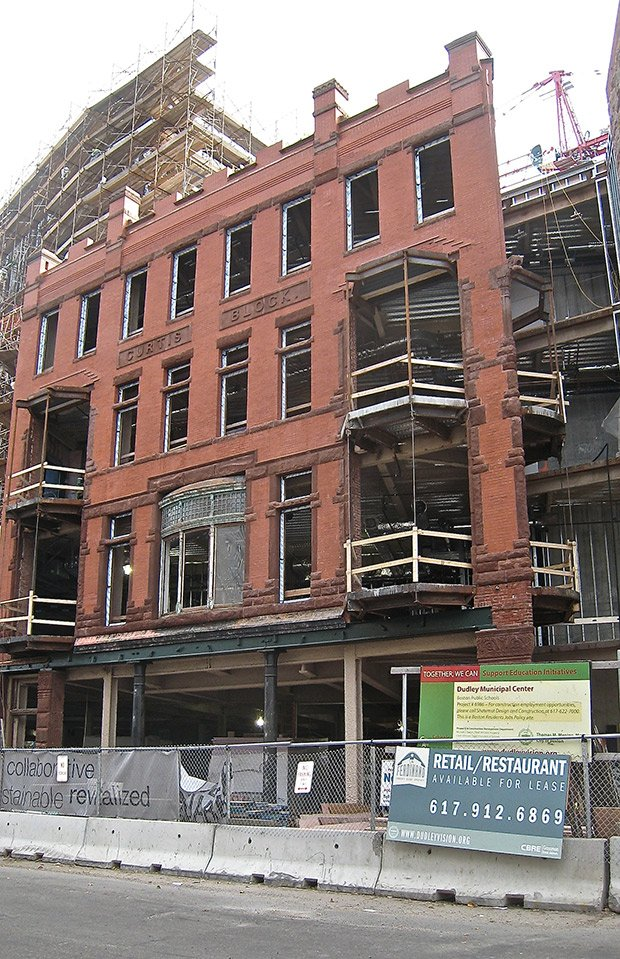Construction on the Ferdinand building, which will house the city's school department, is slated to be completed in 2014. Entrepreneurs seeking to lease retail space on the building's street level have until February 2 to submit bids.