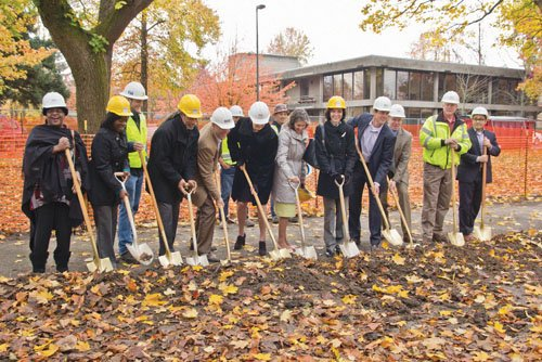 Community members and officials from Portland Parks & Recreation and the Portland Development Commission take hold of shovels to ceremoniously break ground on a $2.6 million renovation project for Dawson Park that honors its rich African-American history.