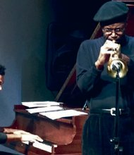 Theo Hill on piano and Charles Toliver on trumpet.