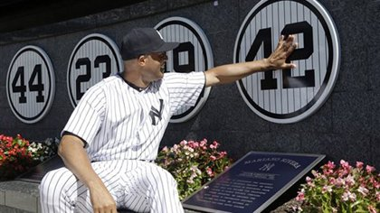 Mariano Rivera touches his plaque in Monument Park as he was honored in a pregame ceremony at Yankee Stadium on Sunday, September 22, 2013.