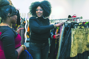 Lynette Voss (right), owner of Vintage & Charmed Classic Clothing in the Anacostia Arts Center in Southeast, discusses fashion trends with her employee Lynette Campbell. Voss hopes that Shop Local Week will attract more customers to her unique store.