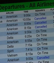 Passengers on nearly 500 flights out of Dallas/Fort Worth airport had to find alternate routes when the storm iced the area over the weekend. This departures board shows cancellations on Monday, November 25, 2013.