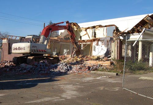 A former Portland Fire Station comes tumbling down on Friday as crews demolish the structure at 4867 N.E. Martin Luther King Jr. Blvd.