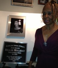 Dr. Theda Palmer Saxton unveils the plaque with a photo of Billie Holiday.