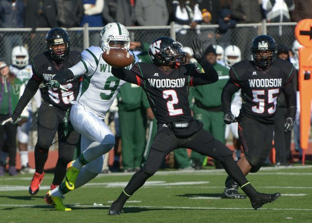H.D. Woodson quarterback Rashad Cooper prepares to throw deep during the 44th Annual Turkey Bowl, a Thanksgiving tradition, in Southeast on Thursday, Nov. 28. H.D. Woodson defeated Wilson, 25-13.