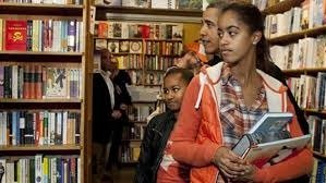 President Barack Obama and his daughters Malia (right) and Sasha visit a bookstore in D.C. on Nov. 30 in support of Small Business Saturday. (Courtesy photo)