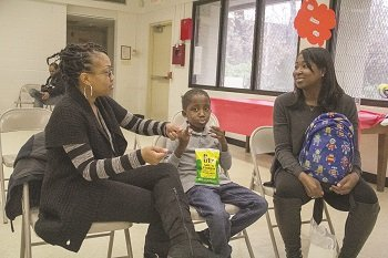 Shanté Harris-Superville (left), executive director of Facing Autism with Children Everywhere (F.A.C.E.), briefly chats with a parent during a four-hour open house for the nonprofit's respite care center on Nov. 16. F.A.C.E.'s Place Respite Care Center, slated to officially open in January, provides an array of services for autistic children and their parents for $40 per session.