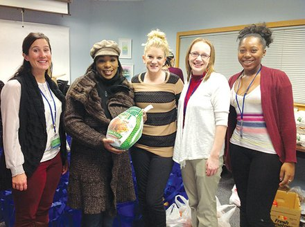 The Neponset Health Center distributes Thanksgiving meals each year with help from a hunger assistance grant from Partners HealthCare. (l-r): Julia Lily, social worker Neponset Health Center; Camille Benson, patient, Neponset Health Center; Ray Perrin, social worker intern, Neponset Health Center; Taffidy Davis, social worker intern, Neponset Health Center; and Cierra Morson, youth peer leader, Neponset Health Center. (Photo courtesy Neponset Health Center)
