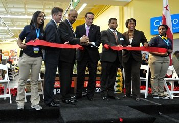 D.C. Mayor Vincent Gray (center) and other city dignitaries cut the ribbon at the grand opening of the Wal-Mart store on Georgia Avenue in Northwest on Wednesday, Dec. 4.