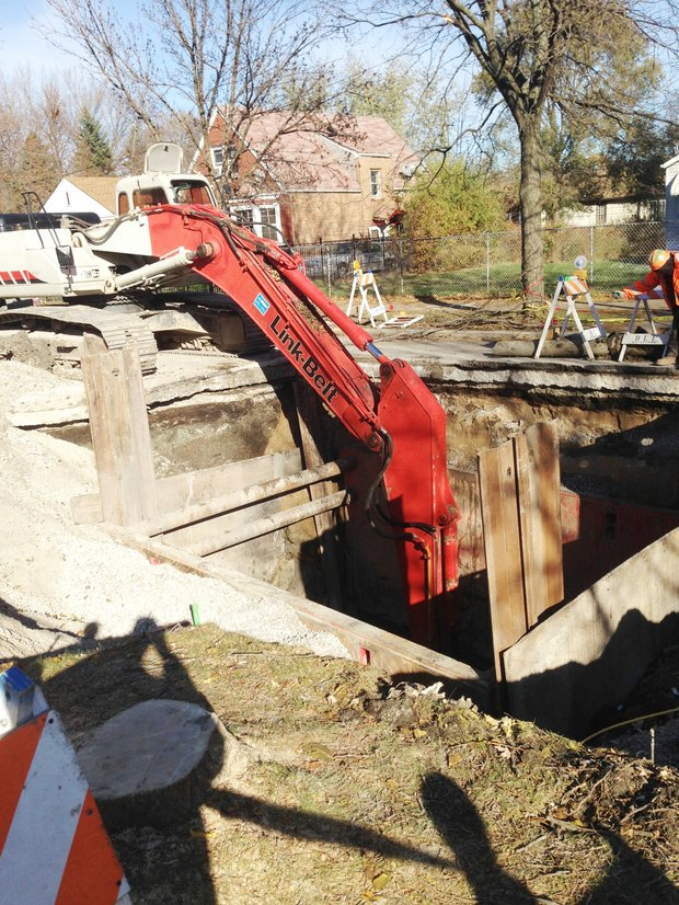 """The  City's infrastructure might have played a significant role in the """"wash out"""" (a sudden erosion of soft soil or other support surfaces by a gush of water) at 124th and Wentworth Ave. which caused the road to collapse creating a large sink hole, because most of its underground pipes and water systems are at or over 100 years old."""