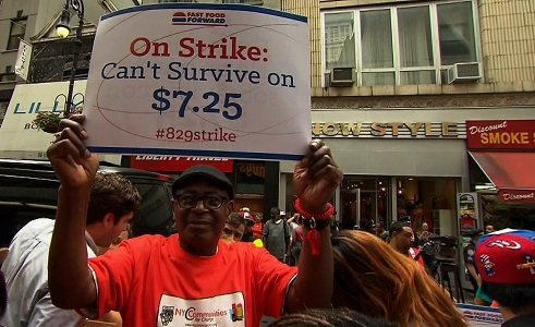 Fast food workers strike in New York City on Thursday, August 29, 2013, demanding a minimum of $15 an hour. Fast food workers in 50 cities across the U.S. are walking off the job Thursday as they protest for higher wages.