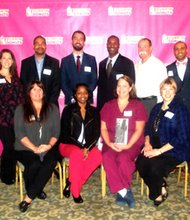 """Recipients of the """"Dunkin' Donuts Community Award"""", and """"Dunkin' Donuts officials during a special recognition ceremony held Wednesday, Dec. 4 at Turf Valley in Ellicott City."""