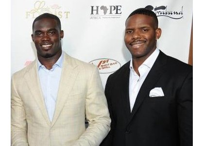 James Ihedigbo, safety for the Baltimore Ravens and founder of HOPE Africa with Michael Ononibaku, board member of HOPE Africa.