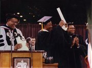 Then TSU President William Harris and Board Chairman Rufus Cormier are shown after awarding the Honorary Degree from Texas Southern University, to Mandela