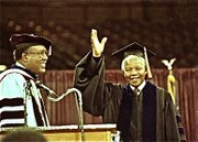 Mandela waves at a auditorium that was filled to capacity