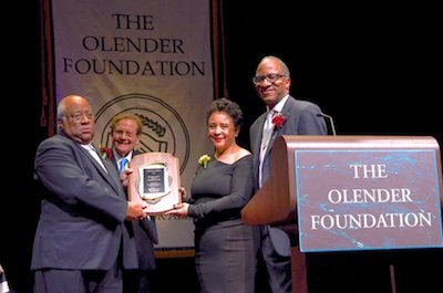 "From left: Charles Allen, representing his father, Eugene ""The Butler"" Allen, is presented with the ""Unsung Hero"" award by Jack Olender, co-founder of the Olender Foundation, BET co-founder Sheila Johnson and Wil Haygood, the journalist who first wrote about Allen at the 28th annual Olender Foundation Awards ceremony in D.C. on Dec. 1."
