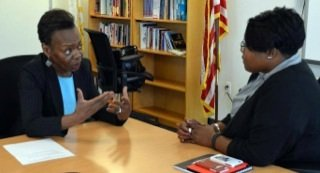 Elizabeth Davis (left), who was elected president of the Washington Teachers' Union earlier this year, chats with Kaya Henderson, D.C. Public Schools chancellor. Davis says the proliferation of charter schools targets the city's most underserved students. (Courtesy of the Washington Teacher's Union)